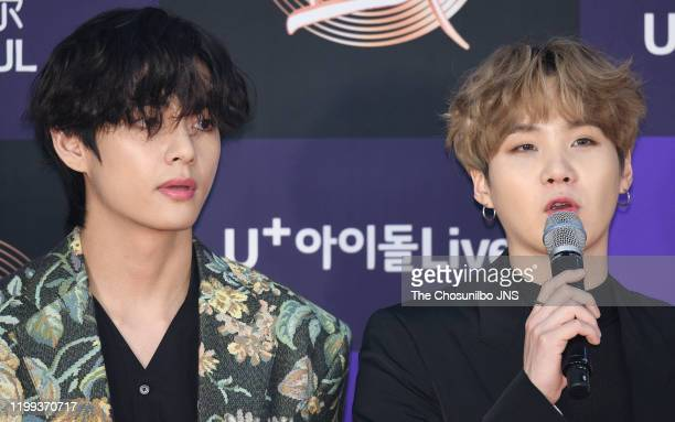 Kim TaeHyung and Suga of Bangtan Boys arrives at the photocall for the 34th Golden Disc Awards on January 05 2020 in Seoul South Korea