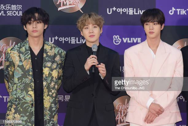 Kim Tae-Hyung, Suga, Kim Seok-Jin of Bangtan Boys arrive at the photocall for the 34th Golden Disc Awards on January 05, 2020 in Seoul, South Korea.