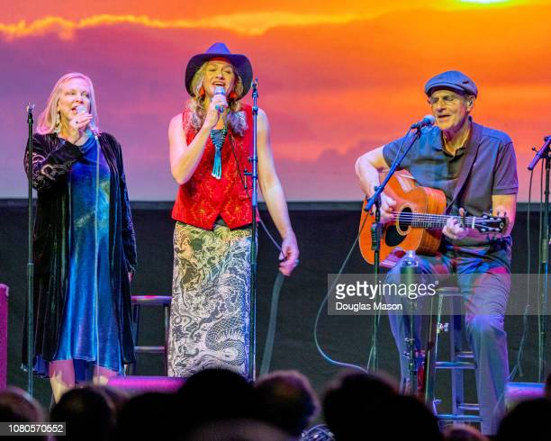 Kim Taylor Sally Taylor and James Taylor perform at the Massachusetts Museum of Contemporary Art Mass MoCA on December 9 2018 in North Adams...