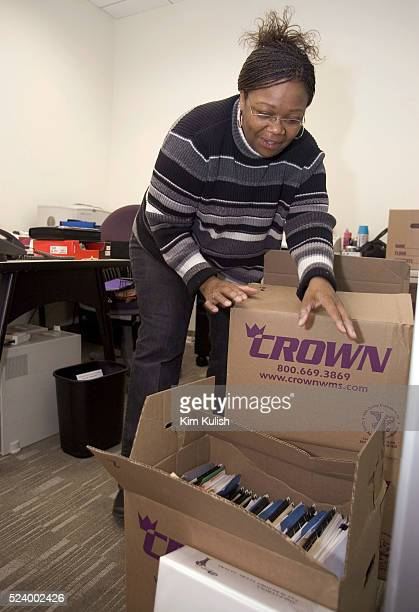 Kim Terrell unpacks her office boxes as Ask Jeeves moves into their new corporate headquarters in downtown Oakland Calif Ask Jeeves has recovered...