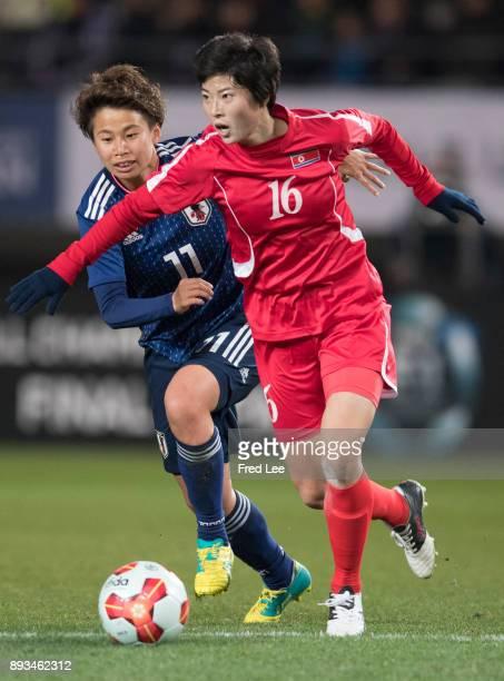 Kim Un Ha of DPR Korea and Tanaka Mina of Japan in action during the EAFF E1 Women's Football Championship between Japan and North Korea at Fukuda...