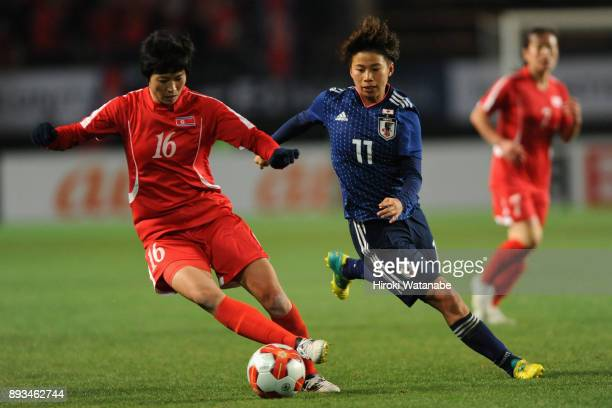 Kim Un Ha of North Korea and Mina Tanaka of Japan compete for the ball during the EAFF E1 Women's Football Championship between Japan and North Korea...