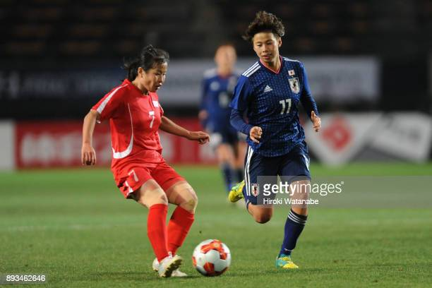 Kim Un Hwa of North Korea and Mina Tanaka of Japan compete for the ball during the EAFF E1 Women's Football Championship between Japan and North...