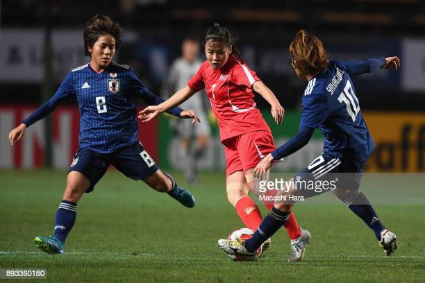 Kim Un Hwa of North Korea competes for the ball against Mana Iwabuchi and Mizuho Sakaguchi of Japan during the EAFF E1 Women's Football Championship...