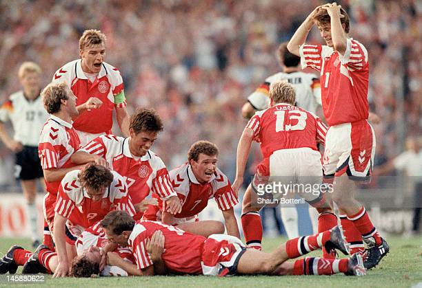Kim Vilfort of Denmark is mobbed by team-mates after scoring the second and winning goal during the UEFA European Championships 1992 Final between...