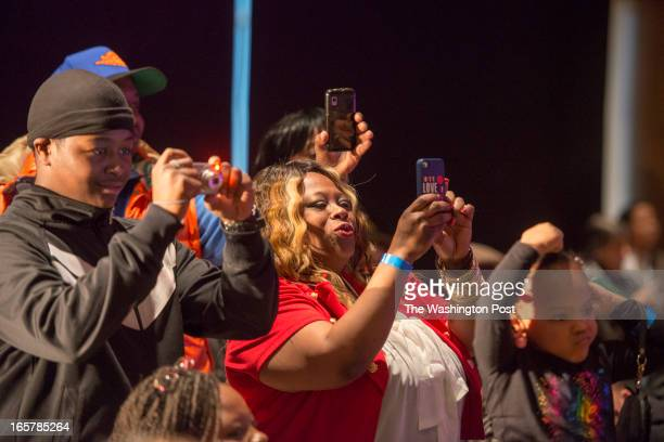 Kim Walker takes pictures of her daughter Kymberly Walker who is on the runway in the 3rd Annual Glynn Jackson's Show Biz Kidz at The Silver Spring...