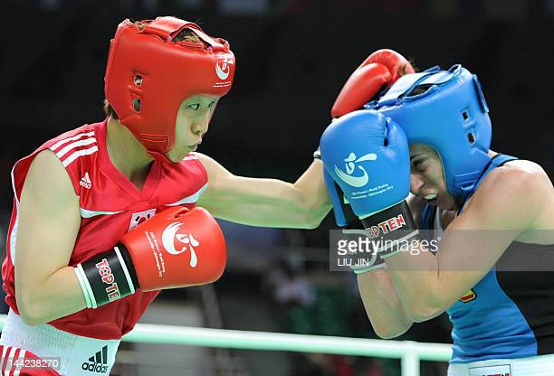 Kim YeJi of South Korea fights against Marta Branas Rumbo of Spain during their women's 51 kg division preliminary match at the AIBA World Women's...