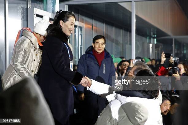 Kim Yo Jong left sister of North Korean leader Kim Jong Un shakes hands with South Korean President Moon Jaein at the opening ceremony of the...