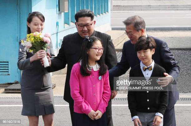 Kim Yo Jong sister and close adviser to North Korea's leader Kim Jong Un brings a bouquet of flowers as he and South Korea's President Moon Jaein...