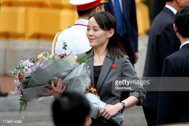 Kim Yo Jong sister of North Korean leader Kim Jong Un holds a flower bouquet during a welcoming ceremony at the Presidential Palace in Hanoi Vietnam...