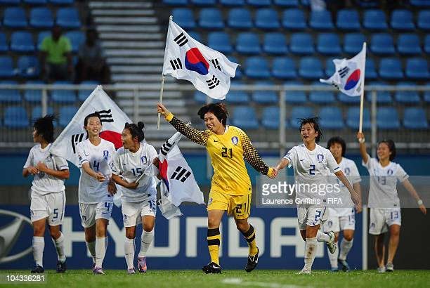 Kim Yoojin and Kim Bichna of South Korea lead the celebrations on the final whistle during the FIFA U17 Women's World Cup Semi Final match between...