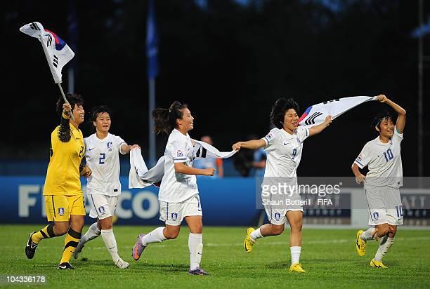 Kim Yoojin Kim Bichna Kim Soobin Kim Dahye and Yeo Min Ji of South Korea celebrate after beating Spain at the end of the FIFA U17 Women's World Cup...