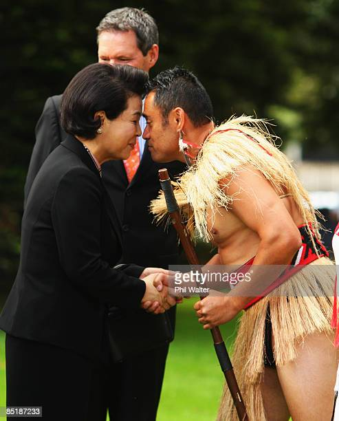 Kim Yoon Ok wife of the President of the Republic of Korea Lee Myungbak is given a hongi by Corporal Francis Leuiz after being welcomed onto the...