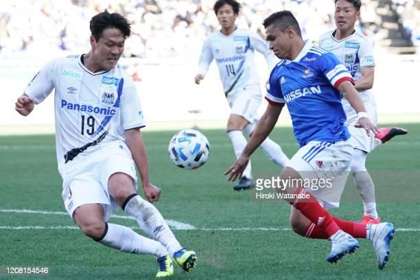 Kim Young Gwon of Gamba Osaka and Erik of Yokohama F.Marinos compete for the ball during the J.League MEIJI YASUDA J1 match between Yokohama...