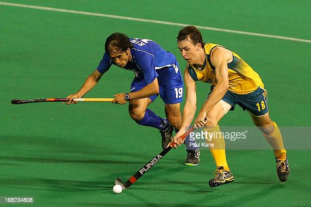 Kim Young Jin of Korea looks to challenge Matt Willis of Australia during the International Test match between the Australian Kookaburras and Korea...