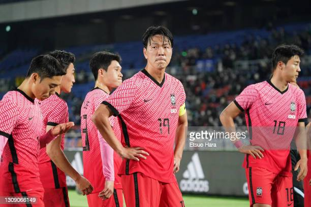 Kim Younggwon and South Korea players show dejection after their 0-3 defeat in the international friendly match between Japan and South Korea at the...