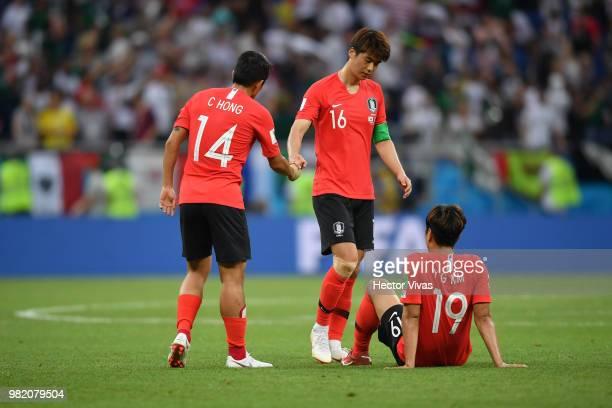Kim YoungGwon Chul Hong annd Ki SungYueng of Korea Republic look dejected during the 2018 FIFA World Cup Russia group F match between Korea Republic...