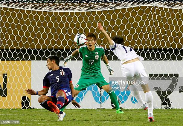 Kim Younggwon of South Korea shoots toward the goal against Japan during EAFF East Asian Cup 2015 final round in Wuhan Sports Center Stadium on...