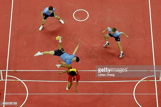 Kim Youngman of South Korea and Zaw Zaw Aung of Myanmar compete for the ball in the Sepaktakraw Men's Regu Semifinal during day thirteen of the 2014...