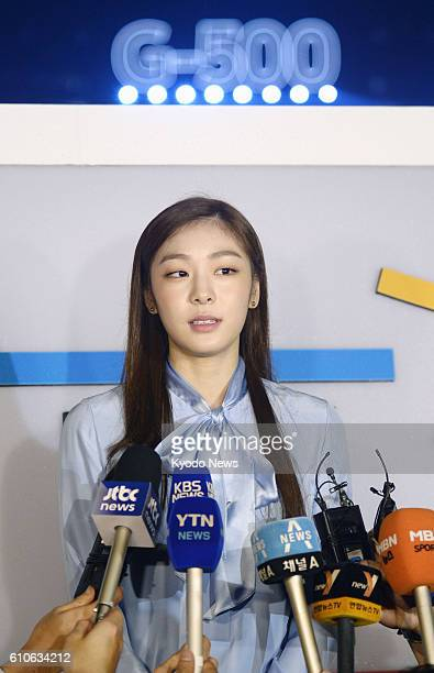 Kim Yu Na the 2010 Winter Olympic figure skating champion speaks to reporters in Seoul on Sept 27 during the 500day countdown event for the 2018...