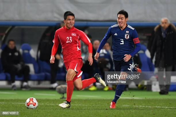 Kim Yu Song of North Korea takes on Gen Shoji of Japan during the EAFF E1 Men's Football Championship between Japan and North Korea at Ajinomoto...