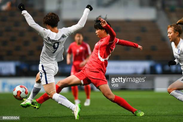 Kim Yun Mi of North Korea and Kang Yumi of South Korea compete for the ball during the EAFF E1 Women's Football Championship between North Korea and...