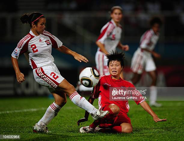 Kim Yun Mi of North Korea battles with Rose Bahadursingh of Trinidad and Tobago during the FIFA U17 Women's World Cup Group A match between North...