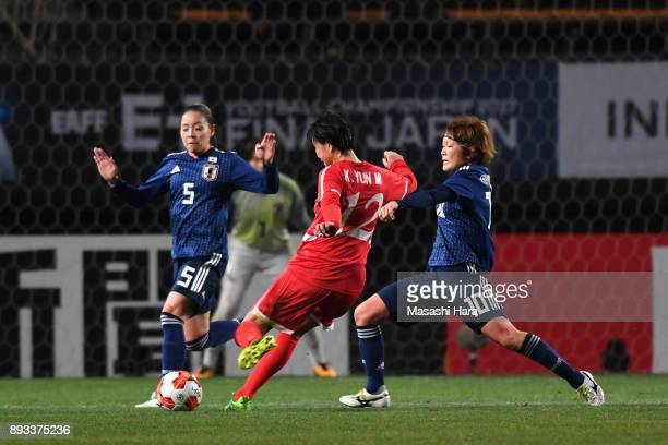 Kim Yun Mi of North Korea scores the opening goal during the EAFF E-1 Women's Football Championship between Japan and North Korea at Fukuda Denshi...