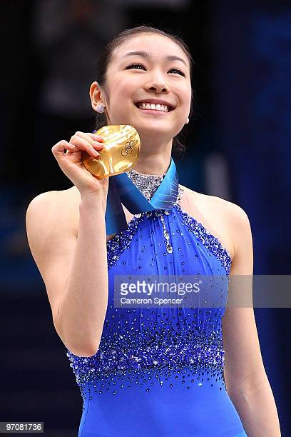 Kim Yu-Na of South Korea celebrates winning the gold medal in the Ladies Free Skating during the medal ceremony on day 14 of the 2010 Vancouver...