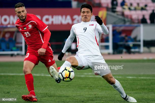 Kim YuSong of North Korea kicks the ball during the AFC U23 Championship Group B match between Palestine and North Korea at Jiangyin Stadium on...