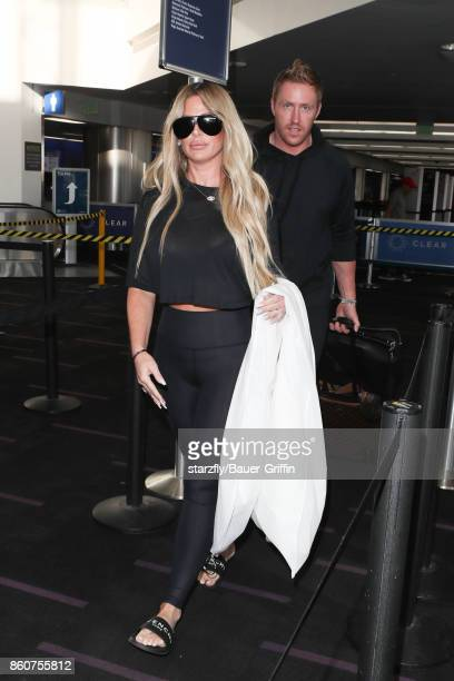 Kim Zolciak and Kroy Biermann seen at LAX on October 12 2017 in Los Angeles California