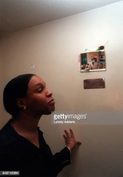 Kima a maletofemale transgender stands underneath a shrine she keeps in memory of her mother in her bedroom in New York City on May 22 1999 Kima and...