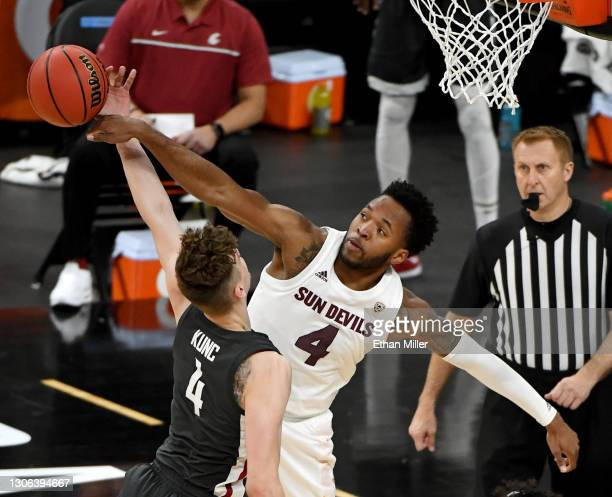 Kimani Lawrence of the Arizona State Sun Devils blocks a shot by Aljaz Kunc of the Washington State Cougars during the first round of the Pac-12...
