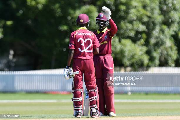 Kimani Melius of the West Indies is congratulated by Keagan Simmons of the West Indies after scoring his half century during the ICC U19 Cricket...
