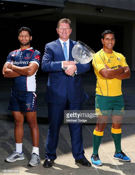 Kimani Situati of the Melbourne Rebels the Premier of Victoria Ted BaIllieu and Cooper Vuna of the Wallabies pose during a photocall with the Tom...
