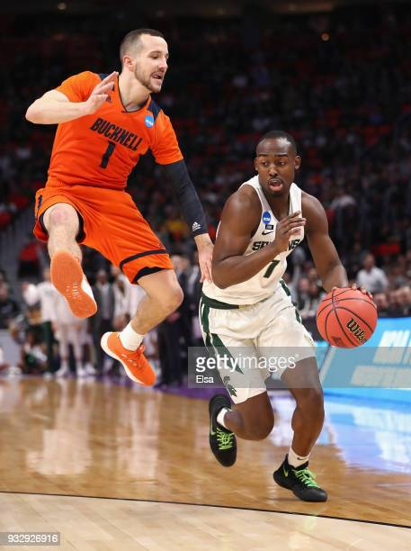 Kimbal Mackenzie of the Bucknell Bison defends Joshua Langford of the Michigan State Spartans during the first half in the first round of the 2018...