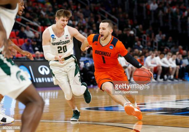 Kimbal MacKenzie of the Bucknell Bison drives around G Matt McQuaid of the Michigan State Spartans during the NCAA Division I Men's Basketball...