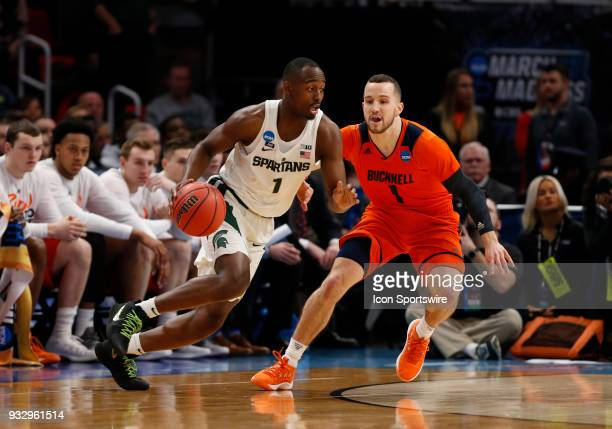 Kimbal MacKenzie of the Bucknell Bison guards G Joshua Langford of the Michigan State Spartans during the NCAA Division I Men's Basketball...