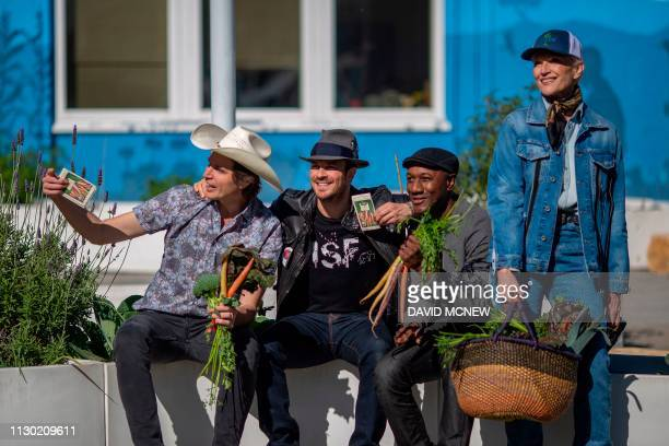 Kimbal Musk brother of Elon Musk actor Ian Somerhalder musician Aloe Blacc and mother Maye Musk pose for a friend as students at Eucalyptus...