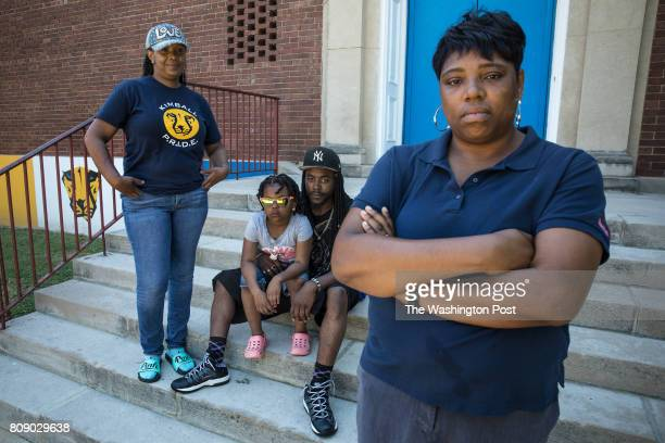 Kimball Elementary School parents Danita Walker Freddie Williams with his daughter Princess and Jeanelle Swiney outside Kimball June 21 in the...