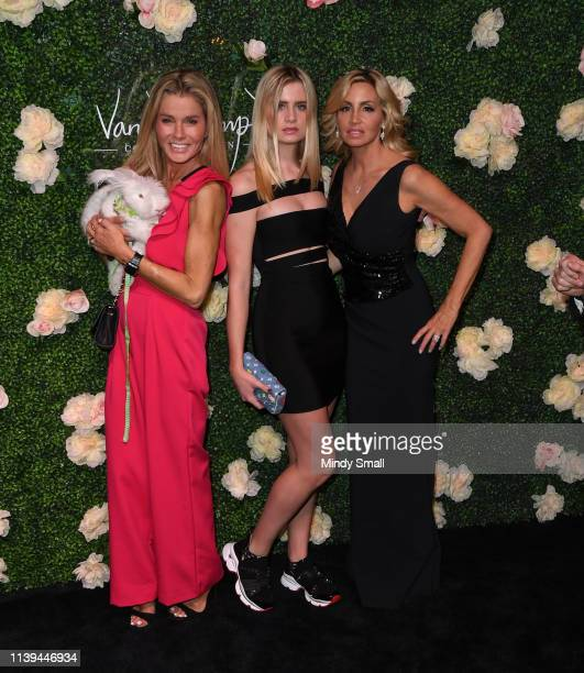 Kimber Sissons Mason Grammar and Camille Grammar attend the grand opening of Vanderpump Cocktail Garden at Caesars Palace on March 30 2019 in Las...