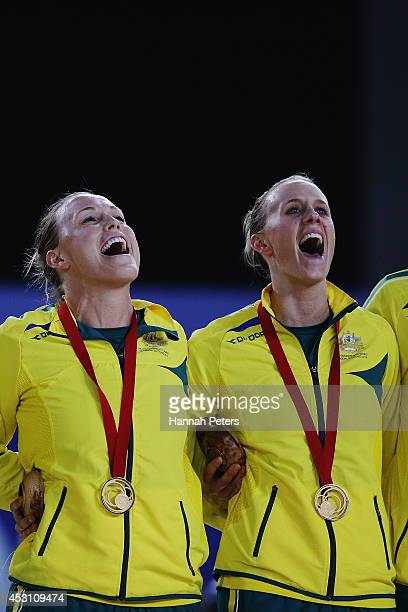 Kimberlee Green and Renae Hallinan of Australia sing the national anthem after winning the gold medal match between Australia and New Zaland at SECC...