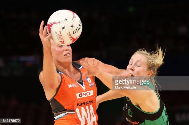 Kimberlee Green of the Giants and Jessica Anstiss of the Fever contest possession during the round two Super Netball match between the Giants and the...