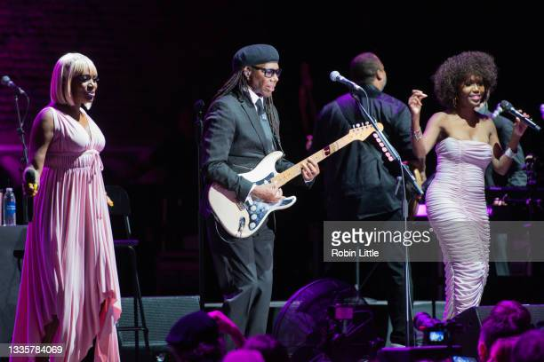 Kimberley Davis, Nile Rodgers and Folami of Chic perform during Hampton Court Palace Festival 2021 at Hampton Court Palace on August 22, 2021 in...