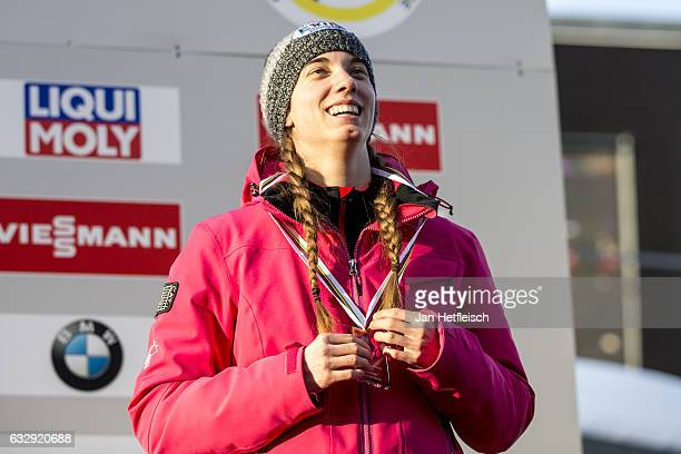 Kimberley McRae of Canada poses for a picture after winning the third place of the Women's Luge competition during the second day of the FILWorld...