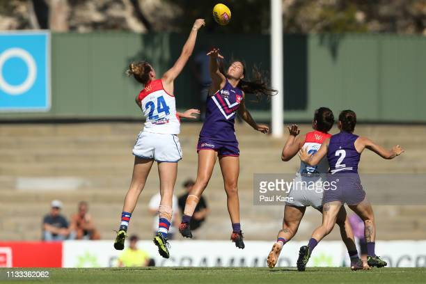Kimberley Rennie of the Bulldogs and Parris Laurie of the Dockers contest the ruck during the round five AFLW match between the Fremantle Dockers and...