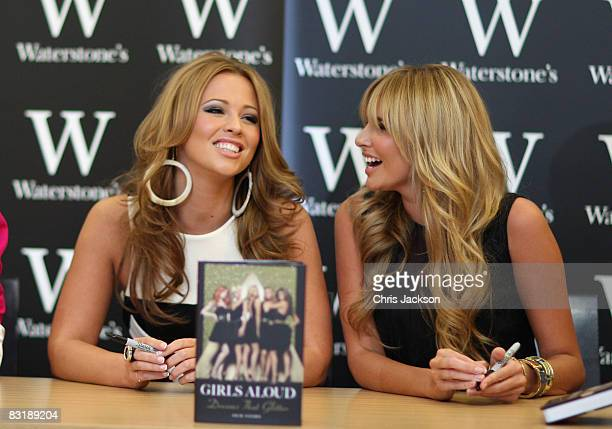 Kimberley Walsh and Nadine Coyle of Girls Aloud pose for a photograph during a book signing for the band's new book 'Dreams That Glitter' at...