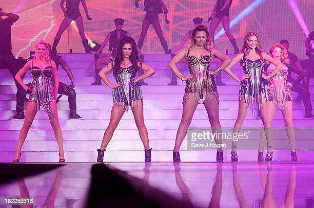 Kimberley Walsh Nicola Roberts Nadine Coyle Cheryl Cole and Sarah Harding of Girls Aloud perform on stage on the first night of their Girls Aloud The...
