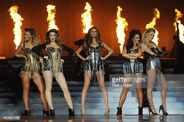 Kimberley Walsh Nicola Roberts Nadine Coyle Cheryl Cole and Sarah Harding of Girls Aloud perform on their 'Ten The Hits Tour' at The O2 Arena on...