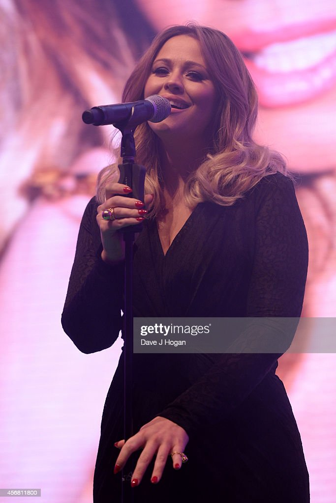 Kimberley Walsh performs on stage at the Spectacle Wearer Of the year Awards at 8 Northumberland Avenue on October 7, 2014 in London, England.